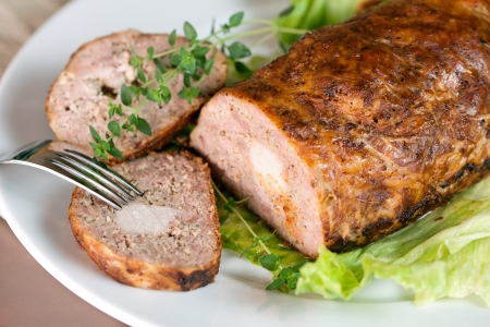 Meatloaf (beef) with salad on white background