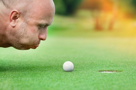 blow hole: Golf club  golfer concentrating on the 18th hole