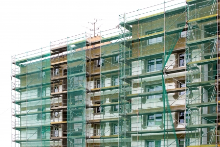 Reconstruction of tower building with scaffolding  Stock Photo - 14920339