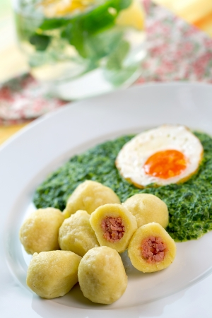 Stuffed potato dumplings with smoked meat and spinach - Czech cuisine,