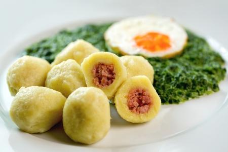 dumplings: Stuffed potato dumplings with smoked meat and spinach - Czech cuisine,