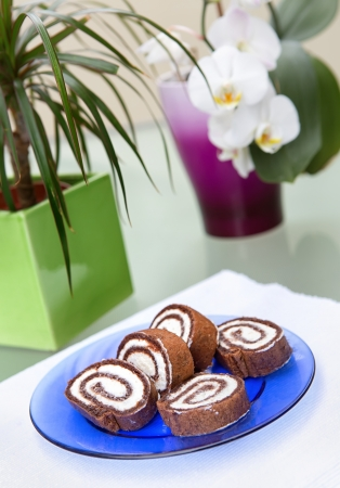 Chocolate roulade with orchid in background photo