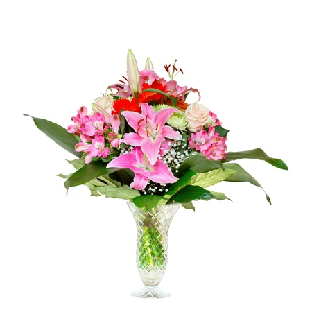floral arrangement: Bouquet of lilies on a white background