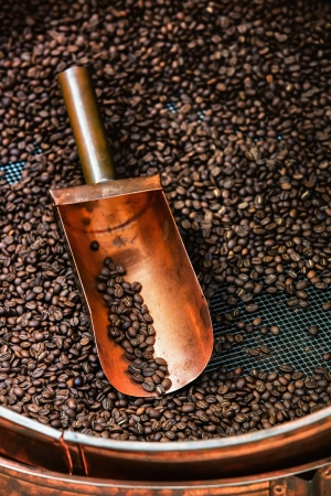 copper spoon in coffee beans with a beautiful light