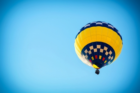 Beautiful colorful hot air balloon in the blue sky photo