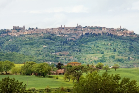 Typical landscape in the Val dOrcia (Siena, Tuscany, Italy) at summer. The view to the town of Pienza photo