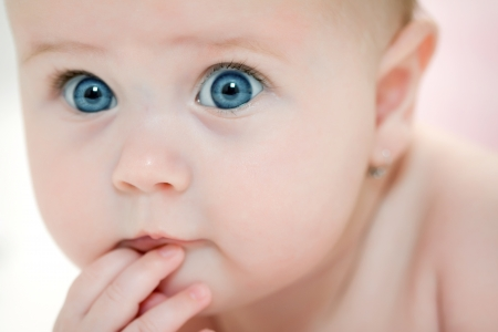 Portrait of beautiful blue-eyed girl Stock Photo