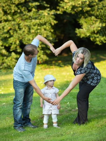 child couple: Young and happy family get stroll in the park    Stock Photo