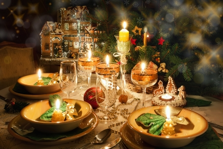 Christmas dinner table with candles with christmas atmosphere Standard-Bild