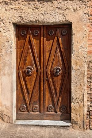 Old door in Tuscany, Italy photo