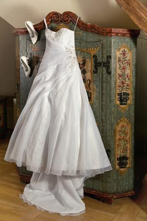Elegant white wedding dress with boots
