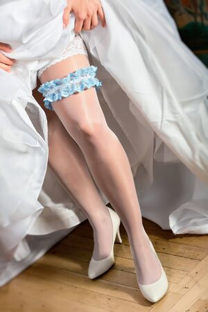 Beautiful wedding garter on leg photo