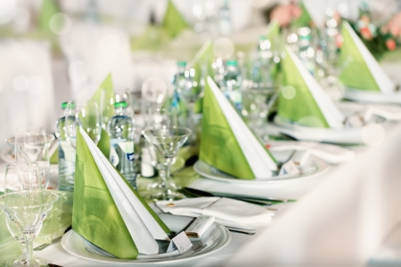 catering service: Festive table setting for wedding, Valentine or other event   Empty place cards on the white festive table