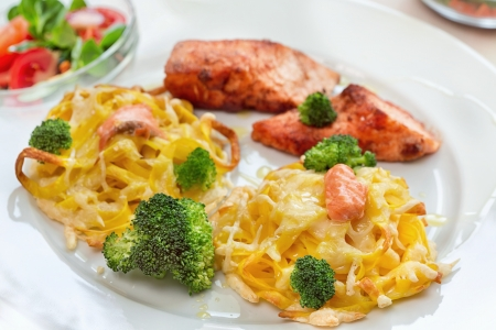 Pasta with salmon and broccoli photo