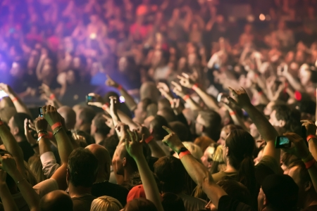 nightclub crowd: Crowd at a music concert, audience raising hands up