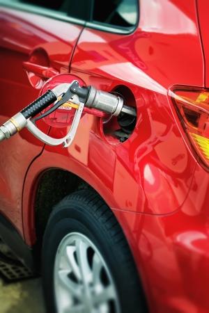 Filling up of liquid gas, LPG at petrol station  photo