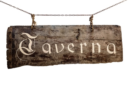 The inscription on the old wooden sign  Taverna  hanging on chains Stock Photo - 21730515