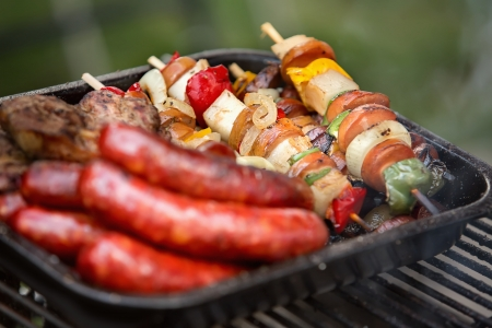 Grilled vegetables, meat and sausage photo