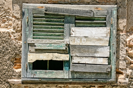 patched up: Window in an old house with boarded up