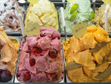 Variety of yummy ice creams under shopping window  Stock Photo