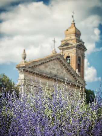 Blooming lavender background with the church in Tuscany, Italy photo