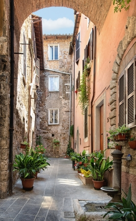 View of a beautiful little street in the old town in Tuscany, Italy
