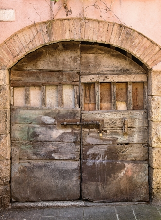 Old door of tuscany in Italy photo