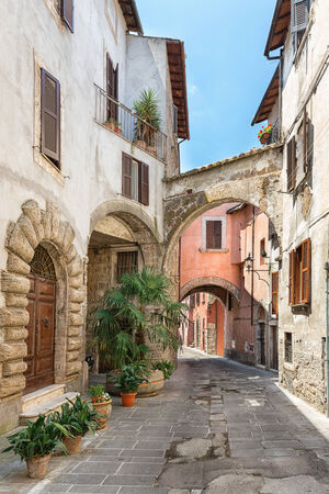 View of a beautiful little street in the old town in Tuscany, Italy photo