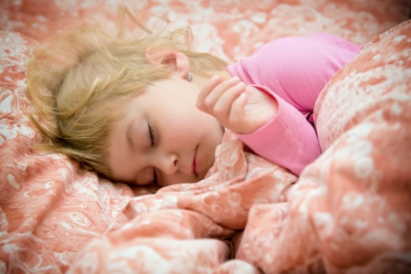 Sweet little girl and her innocent dreams photo