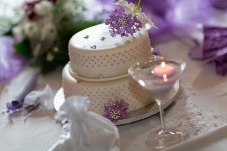 wedding cake: Traditional wedding cake with purple flowers Stock Photo