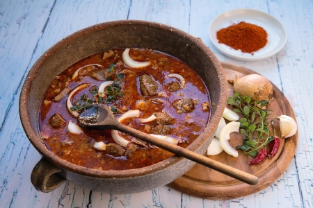 Goulash: Beef stew in a pot and its main ingredients