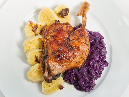 Roast duck, red cabbage and potato dumplings  photo