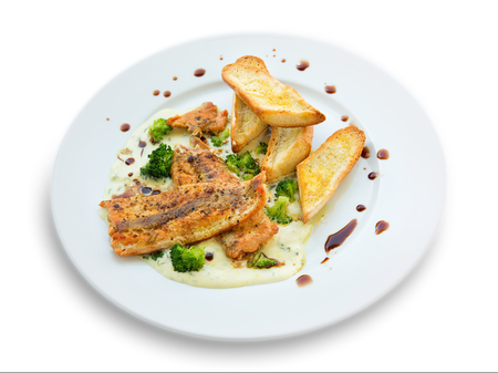 Lightly fried salmon with herb sauce with broccoli and baked baguettes photo