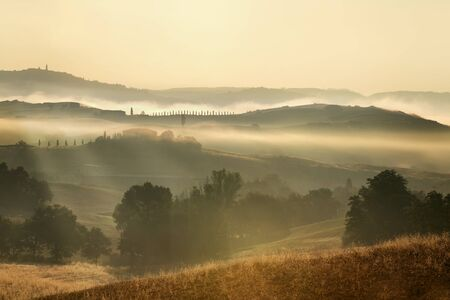 quiet scenery: Scenic view of landscape by sunrise Stock Photo
