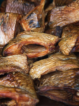 Pieces of smoked carp fish fillets photo