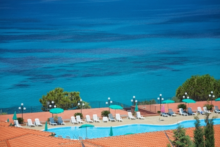 A view of the beautiful sea with swimming pool photo