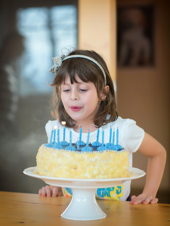 blow out: Girl how to blows candles on a birthday cake