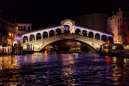 Rialto Bridge (Ponte Di Rialto) in Venice, Italy at night time  Stock Photo