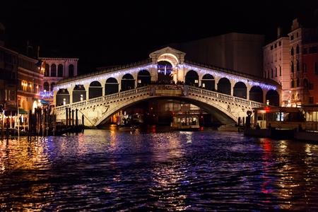 Rialto Bridge (Ponte Di Rialto) in Venice, Italy at night time  photo