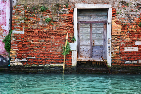 Old door and brick wall in Venice photo