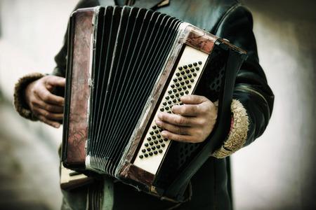 harmonica: The musician playing the accordion
