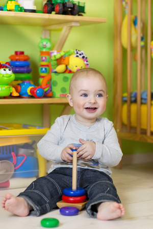 infant school: A one year old child playing in his room Stock Photo