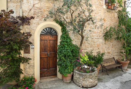 Front door of a beautiful and old villa in Tuscany Stock Photo - 32763361