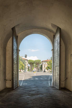 outwards: View the suburbs of the Italian city of Lucca beneath the historic gate outwards
