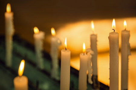 funeral: Several church candles against a dark background