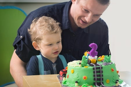 two year old: Little boy celebrating his fathers second birthday,