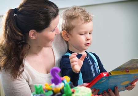 jointly: Mother and son looking at childrens game