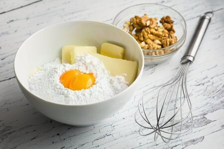 Eggs, flour and butter close-up on wooden table photo