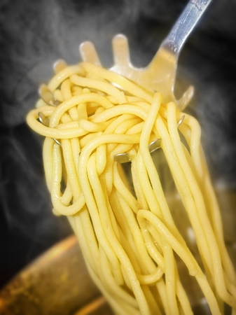 precisely: precisely cooked spaghetti with steam around Stock Photo