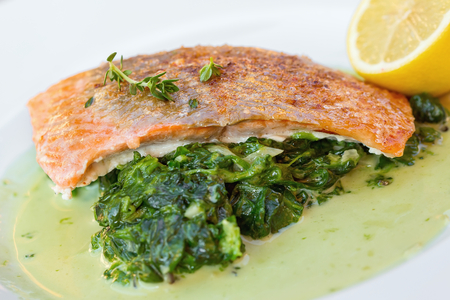 Grilled salmon with spinach and lemon thyme photo